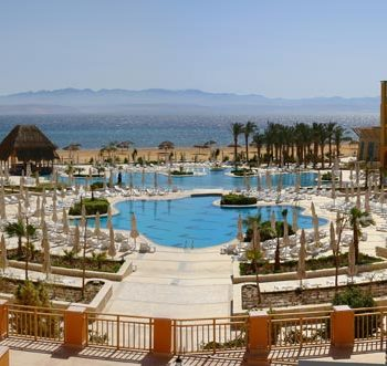 overview of strand beach resort in taba heights with sea and pool view from the hotel