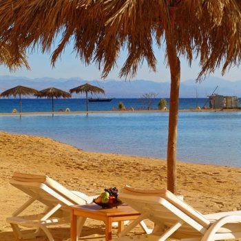 beach seating area at strand beach resort taba heights sinai