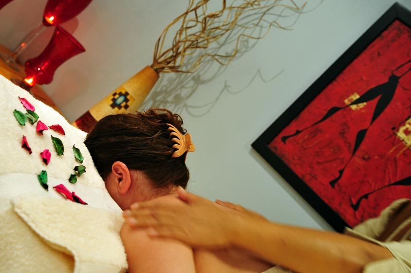 a female guest having a massage at strand beach resort taba heights spa