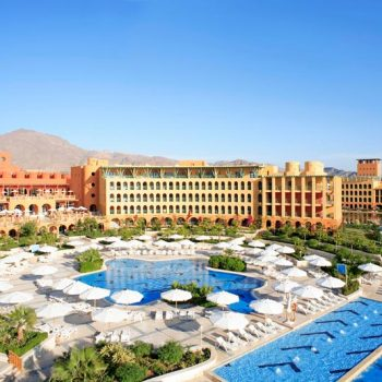 overview of strand beach resort in taba heights with pools and mountains view