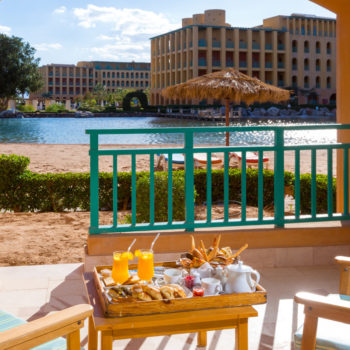 breakfast with lagoon view from strand beach resort room terrace