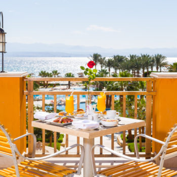 terrace breakfast with pool and sea view at strand beach resort taba heights room