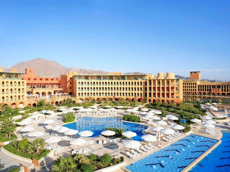 overview of strand beach resort taba heights with pools and mountains view