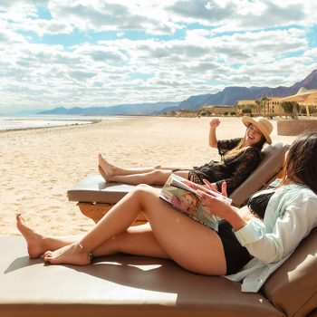 Friends on the beach in Taba heights hotels offer