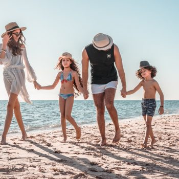 family on the beach in red sea taba heights offer